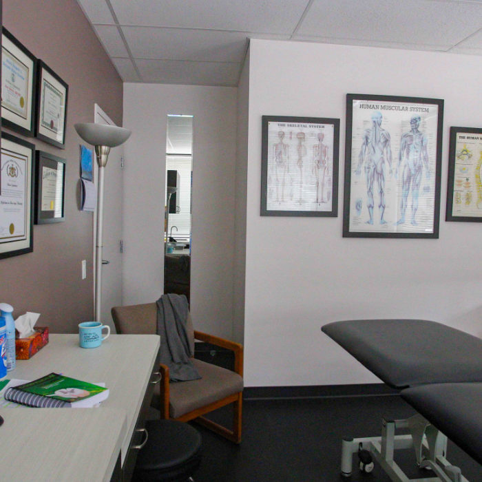 Osteopathic room with degrees and artwork on the walls